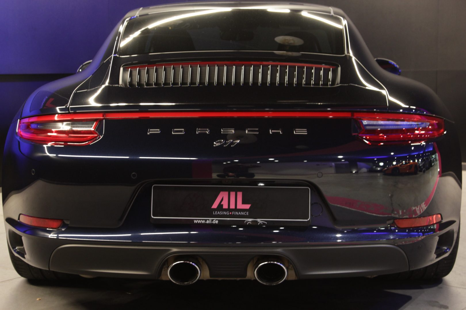 AIL Porsche 991 Carrera 4 BOSE Sportabgas 12